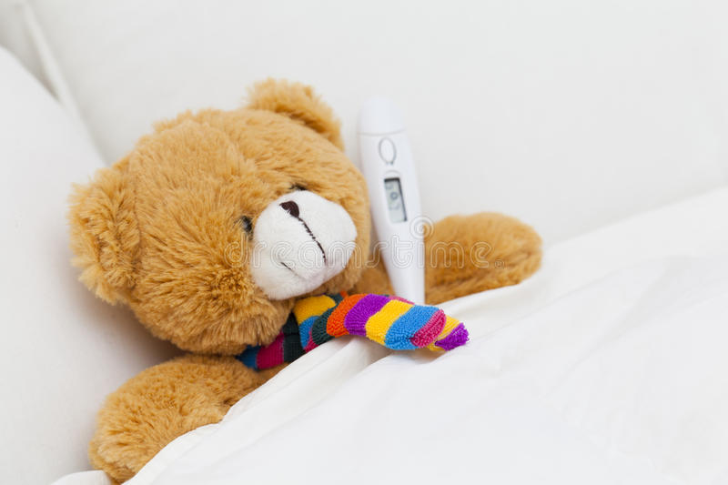 Teddy bear stock photo image of bear fever digital 28499288 teddy bear taking cold temperature in bed altavistaventures Choice Image