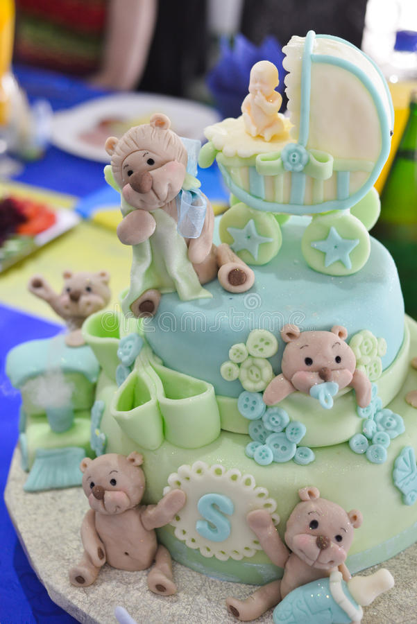 Teddy bear on a baby birthday cake royalty free stock photo