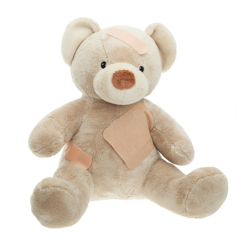 Teddy Bear with bandages. Isolated royalty free stock photos