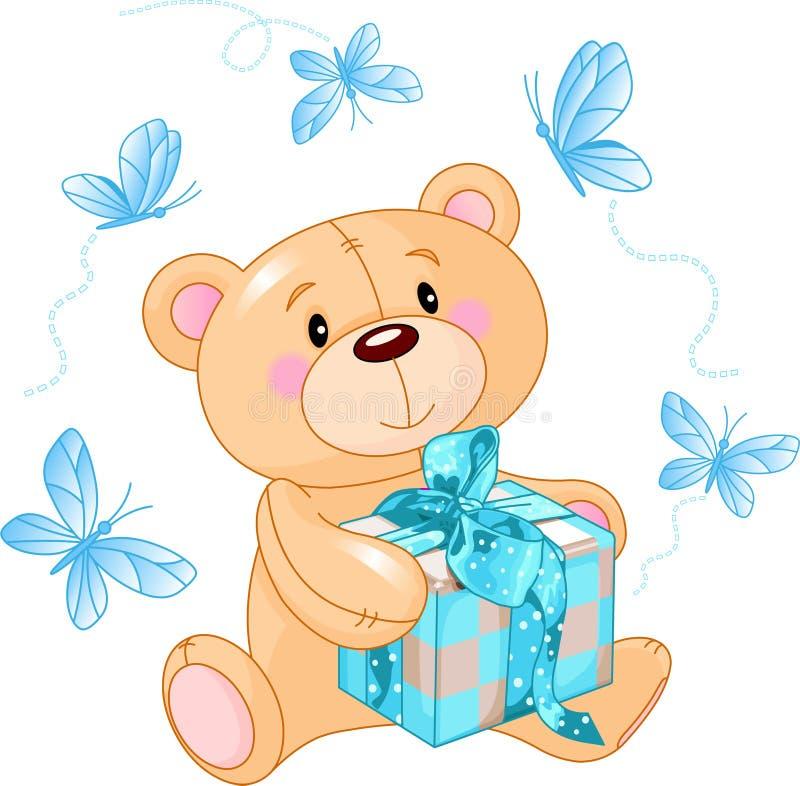 Teddy Bear with blue gift stock photos