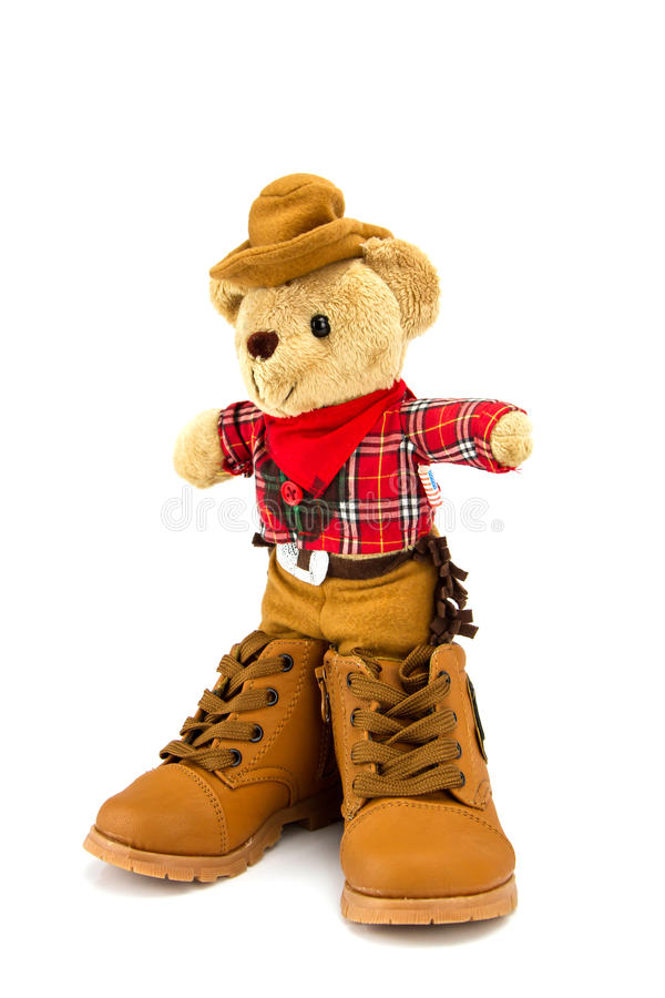 Teddy bear and boots shoes on a white background . Teddy bear and boots shoes on a white background royalty free stock image