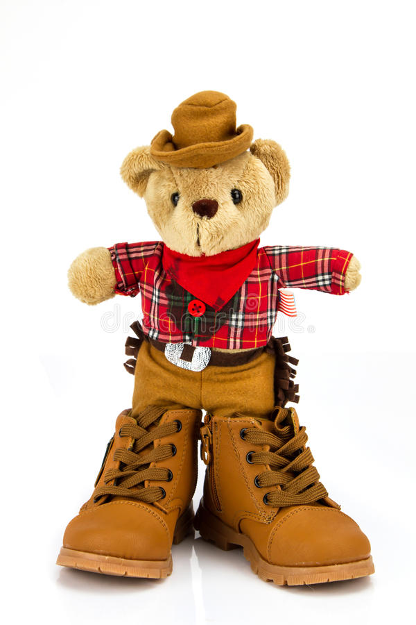 Teddy bear and boots shoes on a white background . Teddy bear and boots shoes on a white background royalty free stock images