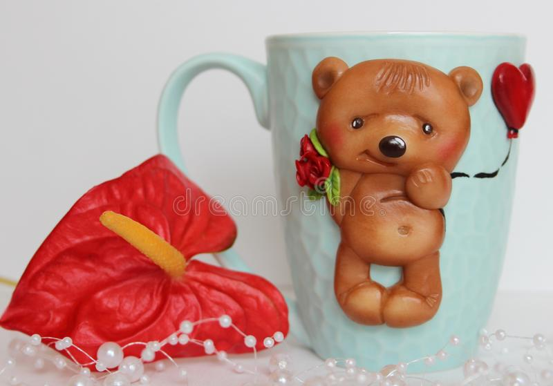 Teddy bear with a bouquet stock photos
