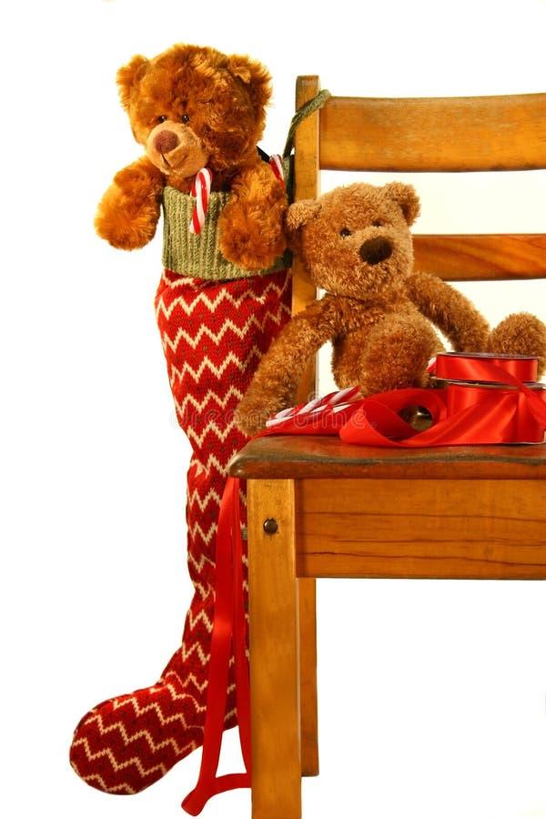 Teddy bear Christmas. Teddy bears placed on an old school chair waiting for Christmas stock photo