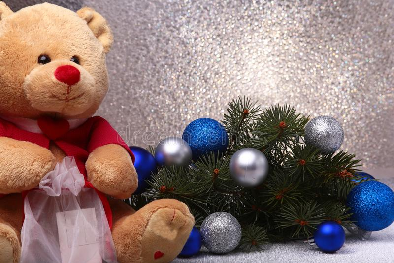 Teddy bear and Christmas decorations on white background.  royalty free stock image