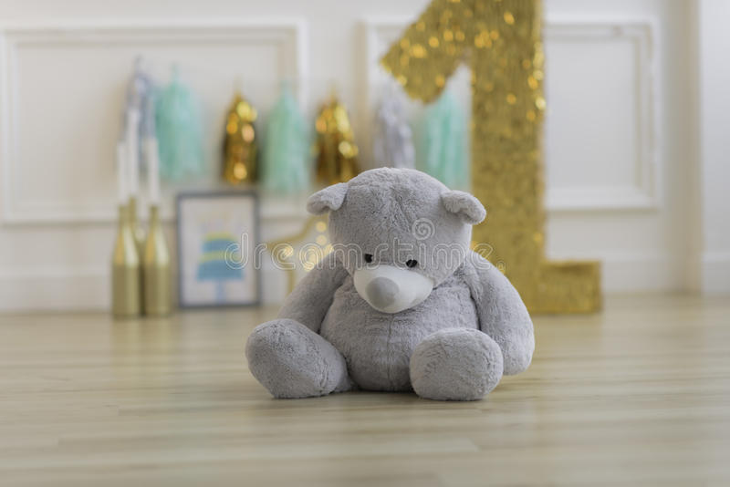 Teddy bear in colourful decoration. Closeup on the background stock image