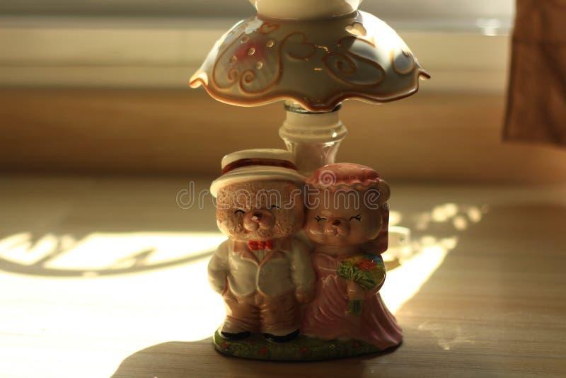 Teddy Bear Cute Ceramic Wedding. White Ceramic Bear On the wooden floor royalty free stock image