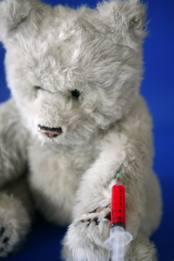 Teddy bear on the doctor stock photo