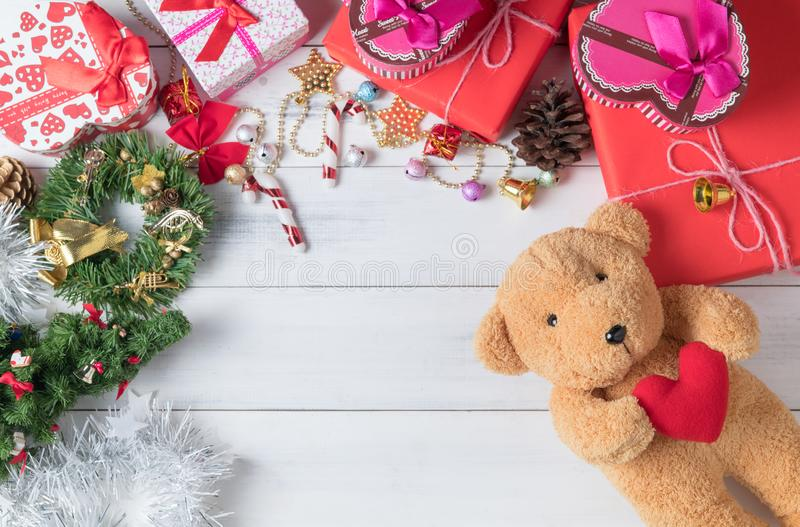 Teddy bear doll and gift box on white wood background,. Cute teddy bear doll and gift box on white wood background, Chrismas and Happy new year concept royalty free stock image