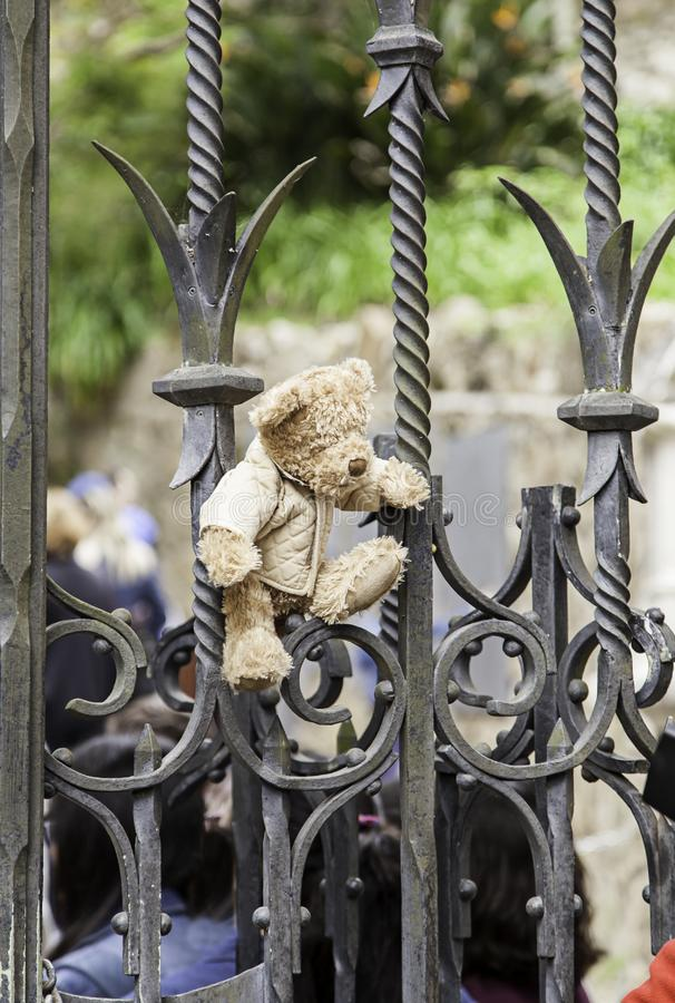 Teddy bear on a fence. Detail of a gift and an omenaje, tragedy stock images