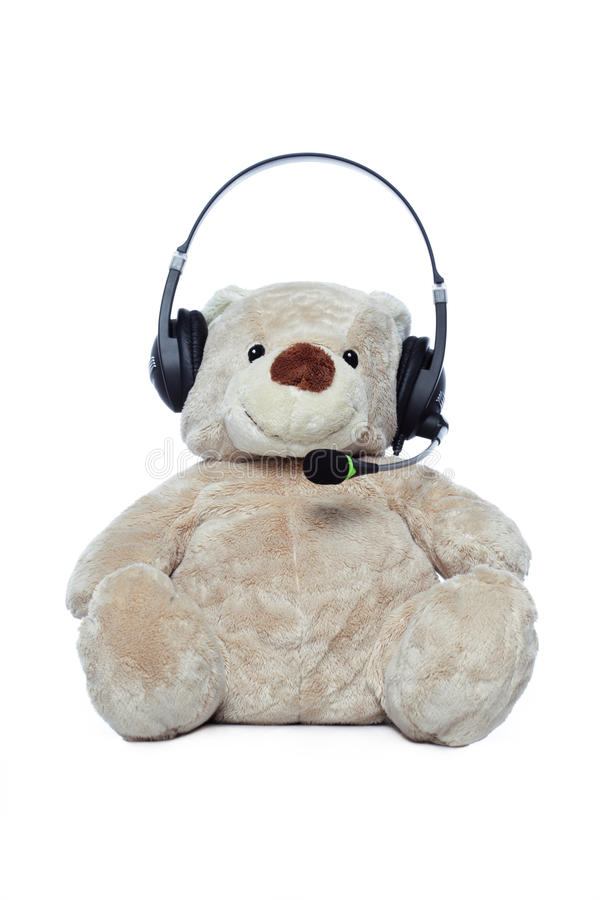 Teddy bear with headset isolated over white royalty free stock photos