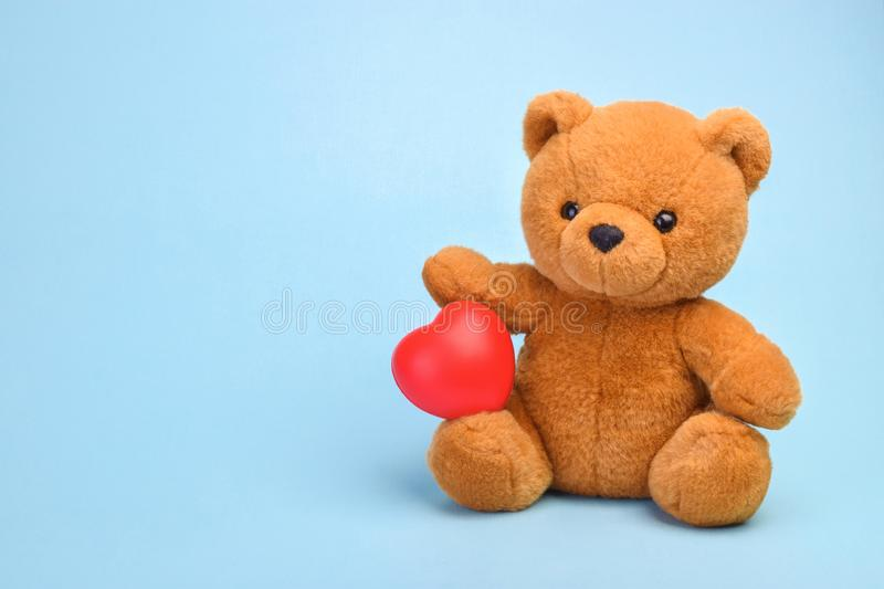 Teddy bear with heart love concept.  stock image