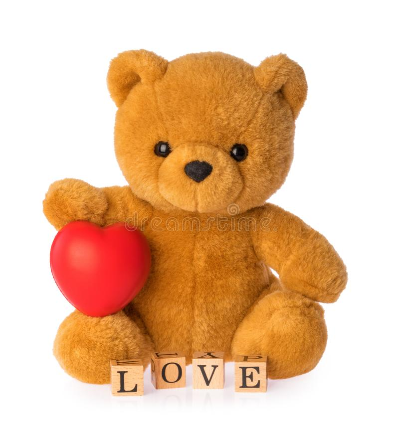 Teddy bear with heart love concept on white background.  stock photography