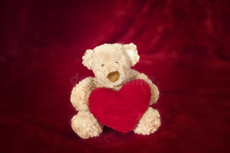Teddy Bear With Heart Shaped Pillow On Red Royalty Free Stock Photo