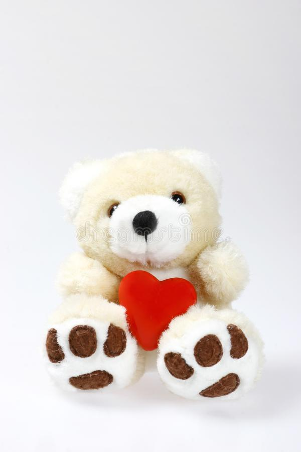 Teddy bear with heart and space stock photography