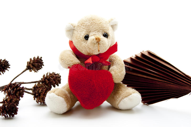 Teddy bear with heart. And wooden fields stock photography