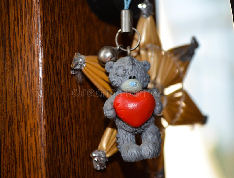 Teddy bear holding heart. A cute teddy bear holding a red heart royalty free stock photos