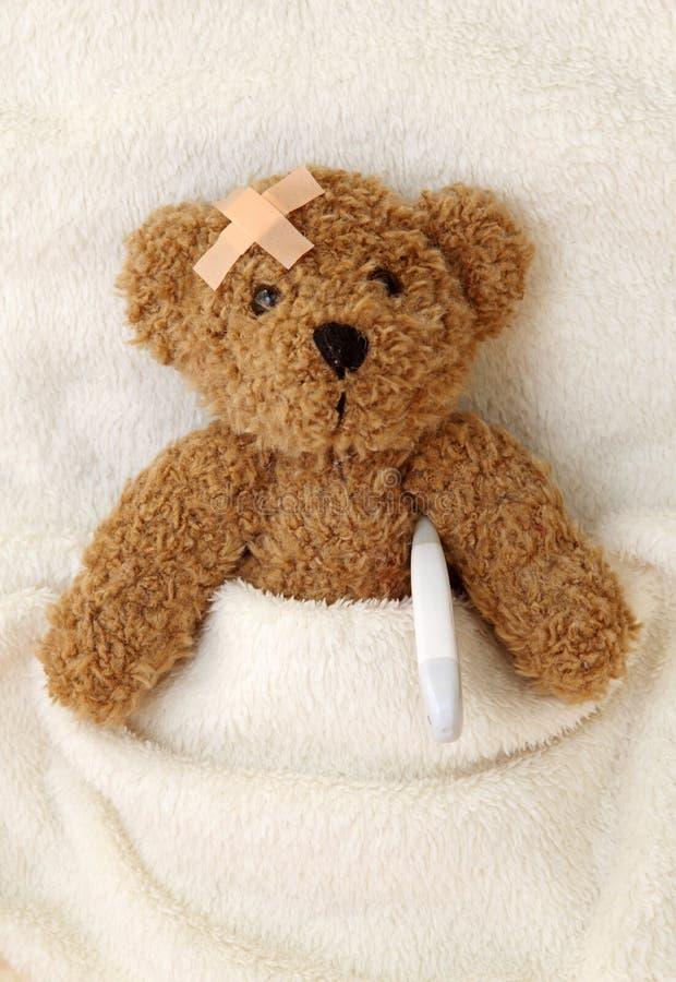 Teddy bear ill royalty free stock photo