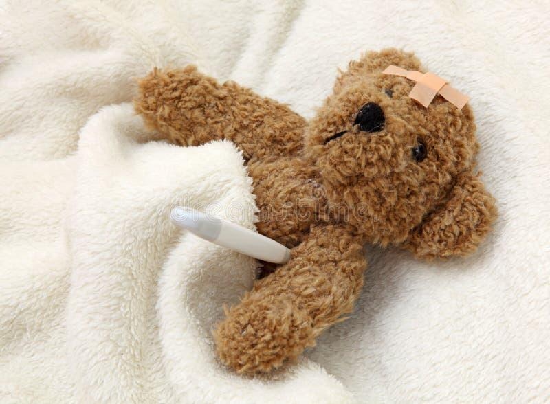 Teddy bear ill stock images