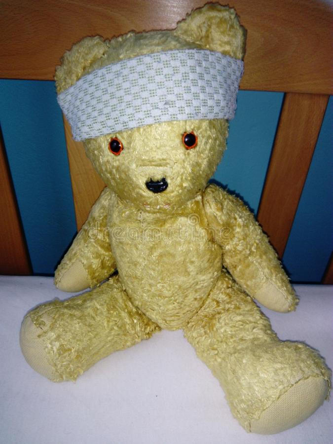 Teddy bear ill on the bed royalty free stock image