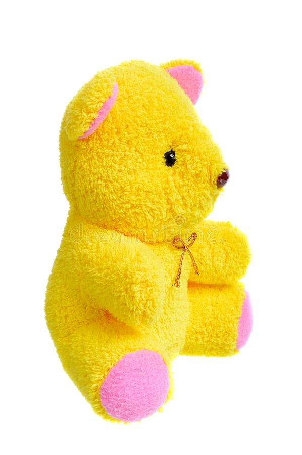 Teddy bear isolated on white background. Yellow doll royalty free stock photography