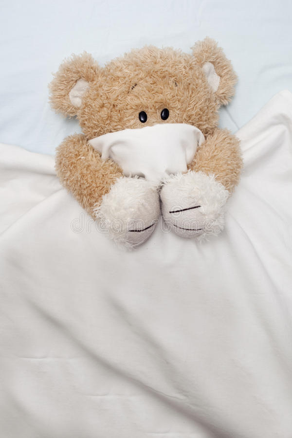 Teddy Bear Laying In Bed Stock Photography