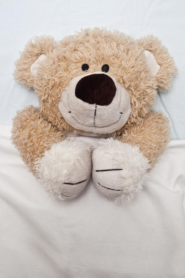 Free Teddy Bear Laying In Bed Stock Photo - 15789250