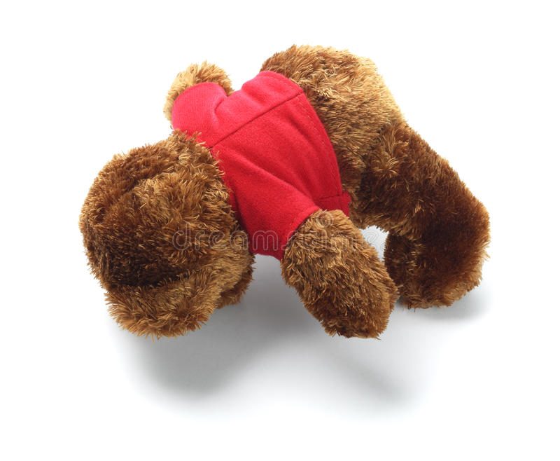 Teddy Bear Lying Face Down. On White Background stock images