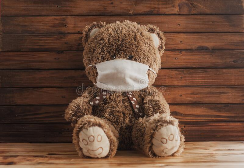 A Teddy bear in a medical mask. concept of infected covid-19 among children.  stock photo