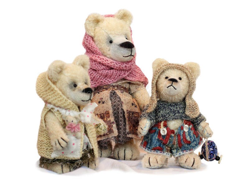 Teddy bear mother with two cubs stock images
