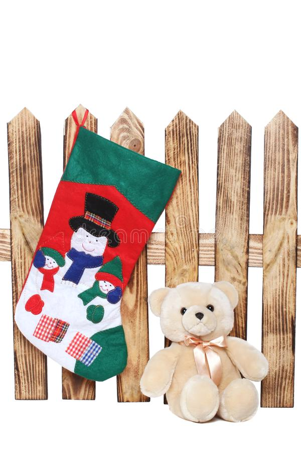 Teddy bear near a wooden fence on a white background. Isolate royalty free stock photography