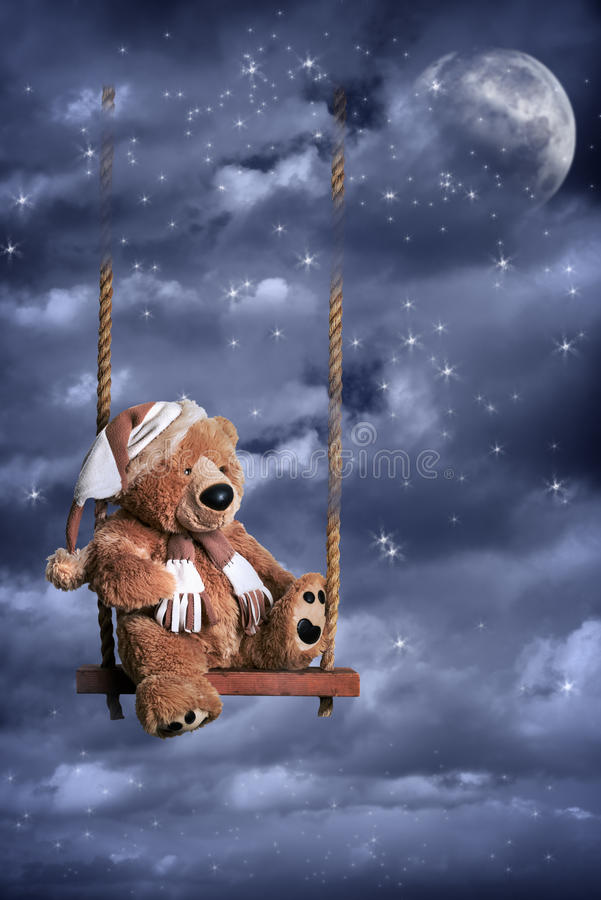 Teddy Bear In Night Sky. Teddy bear on swing against a night sky with moon and stars royalty free stock photos