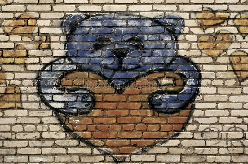 Teddy bear painted on brick wall. Street art royalty free stock photo