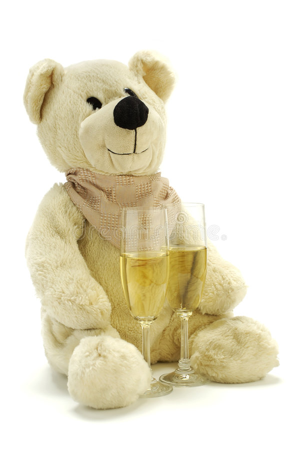 Teddy bear with pair of champagne flutes. Isolated on white stock image