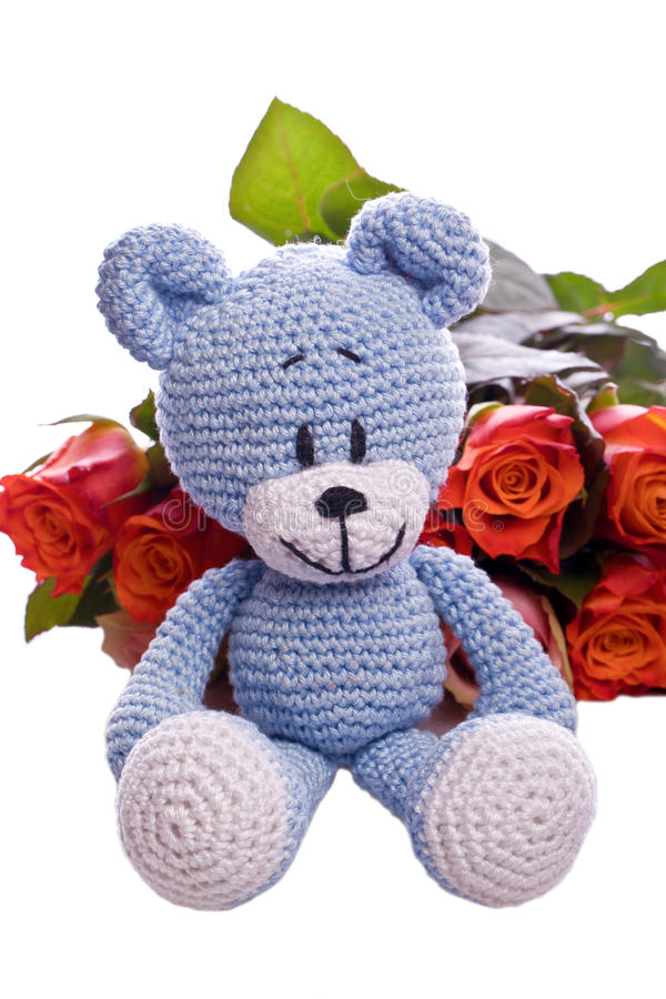 Teddy bear with pink roses royalty free stock images