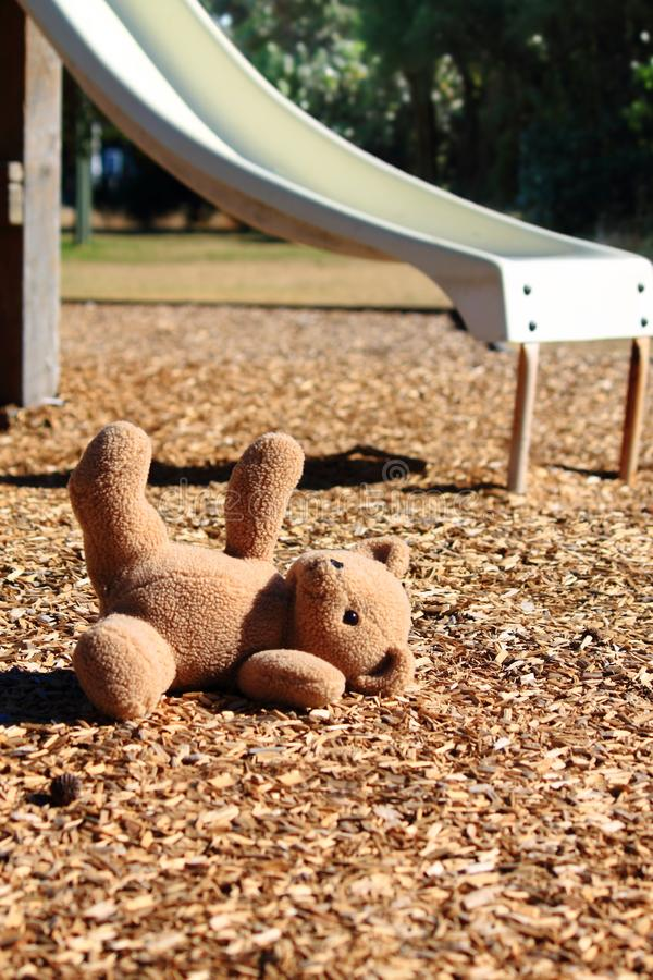 Teddy bear in a playground stock photo