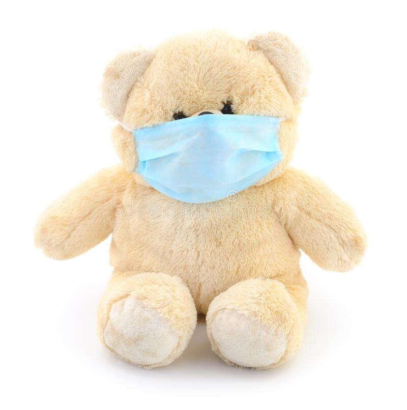 Teddy bear with protective face mask royalty free stock images