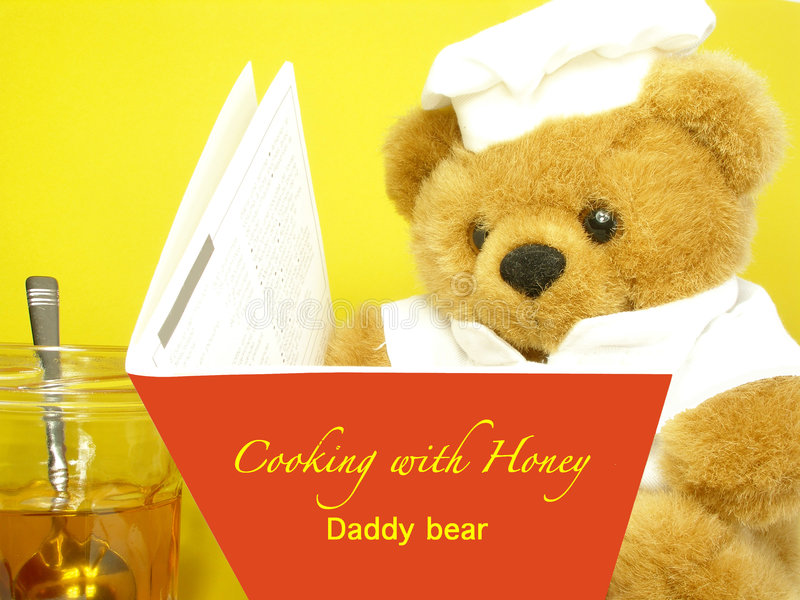 Teddy bear is reading royalty free stock photography