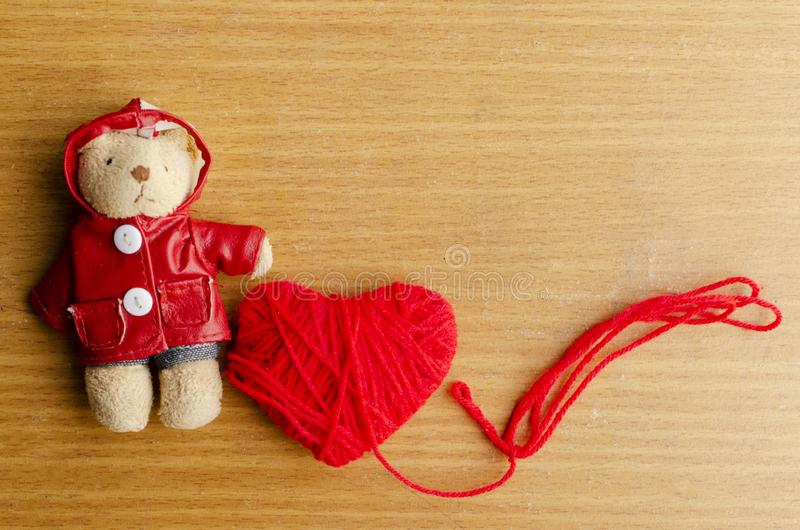 Teddy bear with red heart on wood backgrounds for valentine. Day concept stock photo