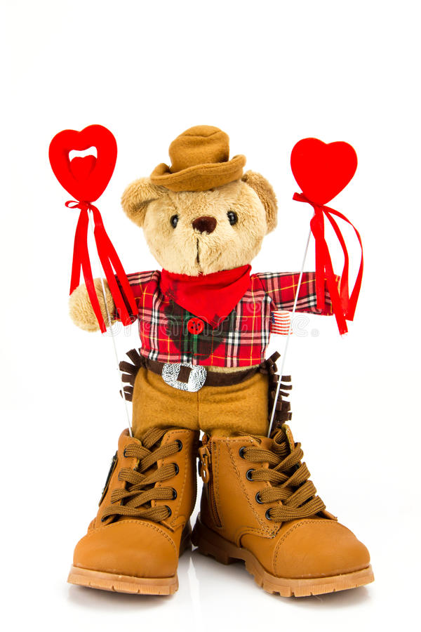 Teddy bear and red hearts on a white background.  stock photos