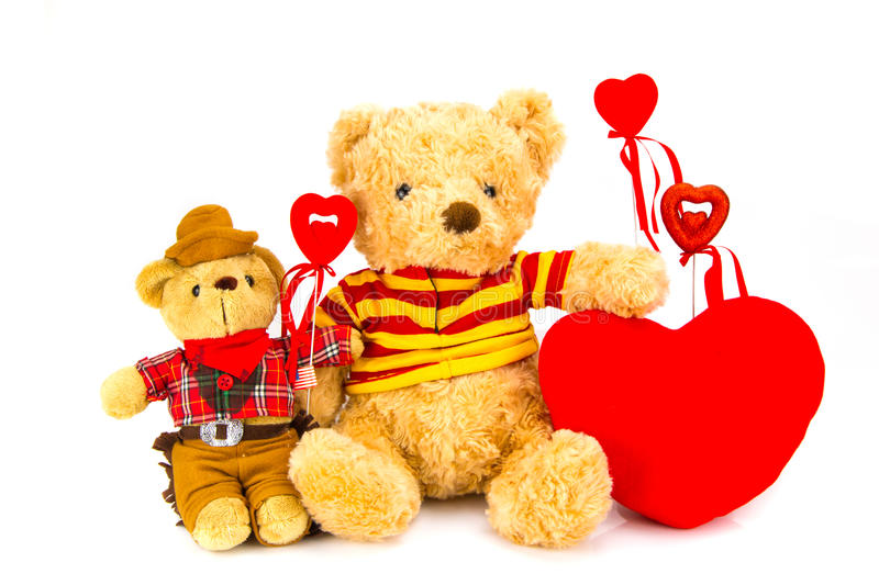 Teddy bear and red hearts on a white background . Teddy bear and red hearts on a white background stock photos