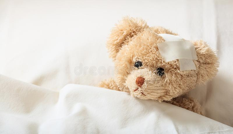 Teddy bear sick in the hospital stock photo