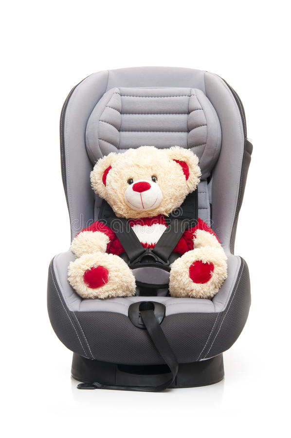 Teddy Bear Sitting On Child's Car Seat Stock Image - Image of child