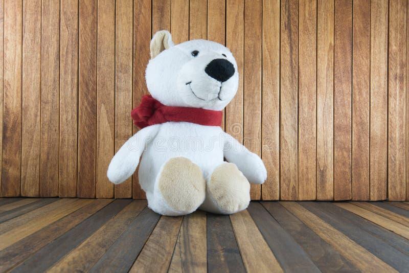 Teddy bear sitting on old wood background. Teddy bear sitting on old wooden background stock images
