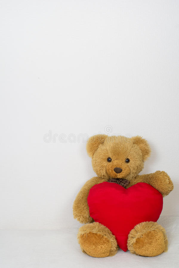 Teddy bear with soft heart royalty free stock image