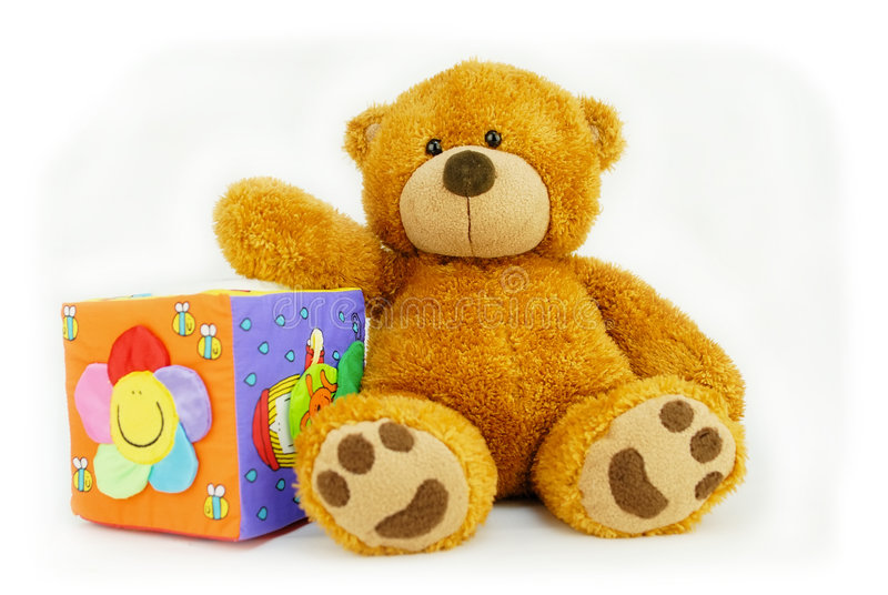 Teddy bear and toy cube royalty free stock photography