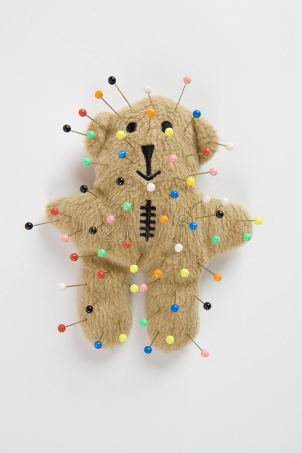 Teddy bear voodoo. A quirky teddy bear like a voodoo doll isolated royalty free stock photography