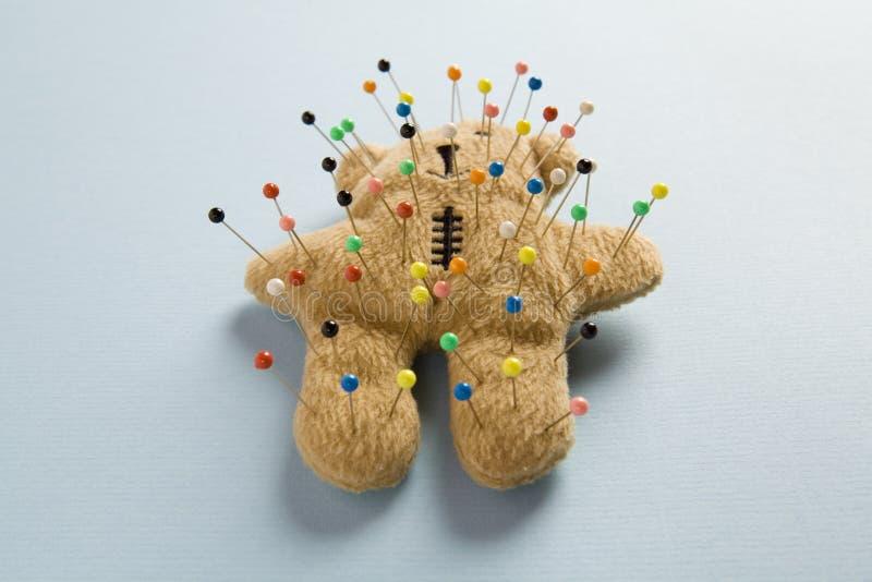 Teddy bear voodoo. A quirky teddy bear like a voodoo doll isolated stock photos