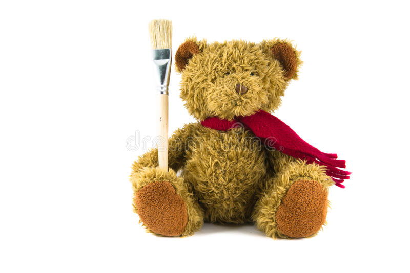 Teddy bear on white background with brush. Teddy bear with brush on white background stock photography