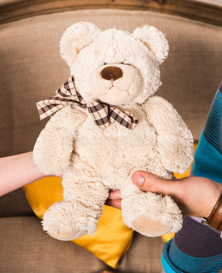 TEDDY BEAR white color. Sitting on a hands royalty free stock images